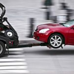 can a tow company keep my car